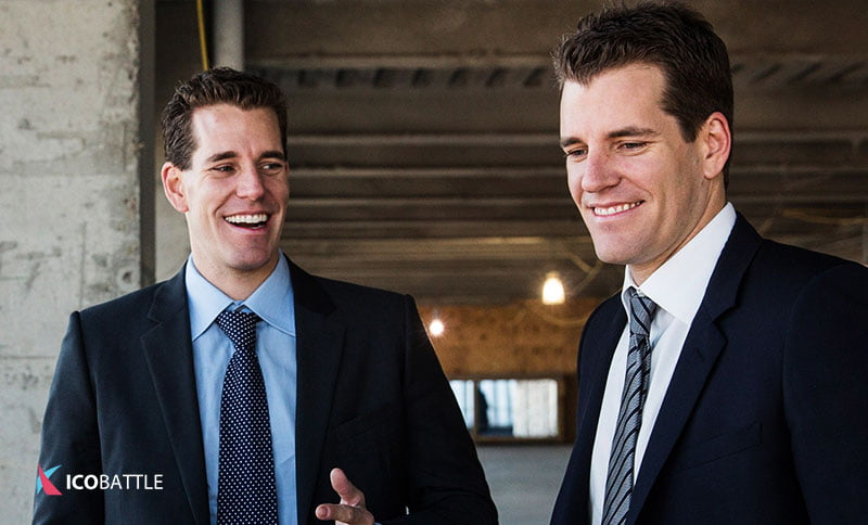Picture with bitcoin millionaires Cameron and Tyler Winklevoss.